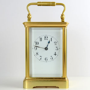 Antique French carriage clock with polished brass case